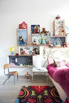 amazing idea...wall paper in the shelfs!    from featherandnest blog