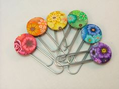 A Rainbow of Millefiori Floral Handmade Polymer Clay Bookmarks/Paperclips. $12.00, via Etsy.