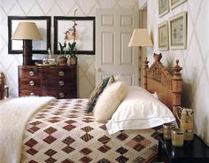 The walls of a tiny guest room are custom-painted in a bamboo lattice pattern. In keeping with the theme, the bed is vintage American faux bamboo and the bamboo floor lamp is a Moschino design.    - HouseBeautiful.com