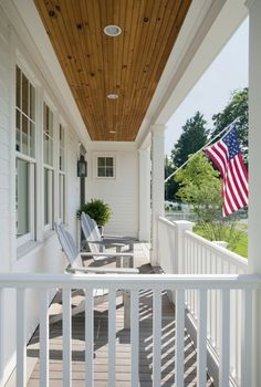 love the natural wood ceiling on this covered porch