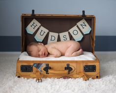 Have a custom baby-name banner ($15) created to add an element of personalization to your little one's first photo shoot.
