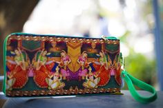 Beautiful Indian Print Clutch at Tiara By Roshini Shah - Grab this beautiful Indian print clutch and add that zeal to any outfit!