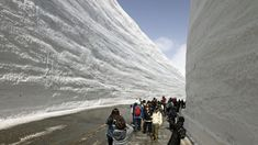 Snow walls as tall as 17 meters high line a sightseeing route through the Tateyama mountain range in central Japan's Northern Alps