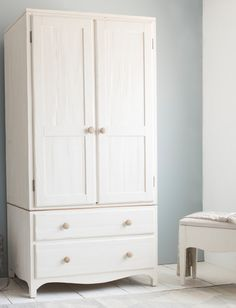 Loaf's white Farmhouse-style wardrobe with wooden handles and heaps of handy storage space and extra drawers