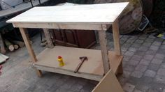 workbench made of scraps that I found around the house. Most of the scraps are leftovers from other projects. An excellent example of upcycling garbage