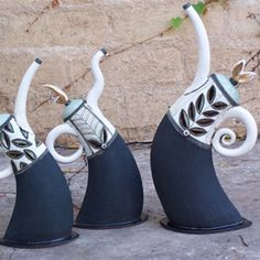 Teapots by Hennie Meyer - I'm thinking arm position