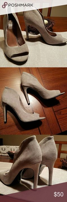 """New Vince Camuto Suede Peep toe heels Very Sexy 4"""" baby soft suede Vince Camuto pumps in light dove gray. Peep toe and high ankle collar ads some extra oomph. NWOT, Never worn and no scuffs, no wear on bottom, a few glue spots in interior pic 7, can not be seen when wearing. Just a tad too small for me. Vince Camuto Shoes Heels"""