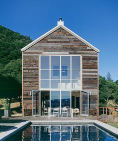 Love this barnwood siding, the way the hillside intersects the house in the background and of course, the pool. Perfection!