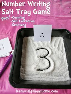 Salt tray math game - have child count (or subitize) the dots on the card, then write the number in the salt. On the back of the card is the correct number so the child can check their work.