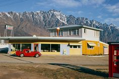 The Hi-Way Diner in Frankton, Otago, with The Remarkables in the distance by Gladys Goodall, 1960s.