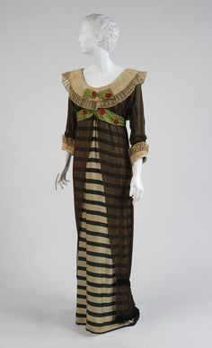 Evening dress, 1910, by Paul Poiret. Green and ivory striped silk, black silk chiffon, and white linen.