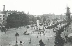 """Gezicht op de Coolsingel, met de Coolsingel ziekenhuis, en de calandmonument, en op de achtergrond korenmolen """"de hoop"""" 1916"""