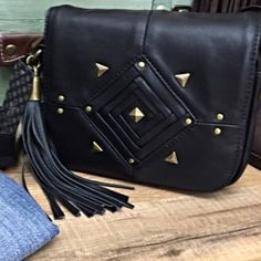 """Miss Me Black Studded Grace Crossbody- New w/Tags Look ultra chic in with this Miss Me God's Eye Grace crossbody bag. It is the perfect addition to any outfit and every closet needs one little black crossbody. Made out of vegan leather with stud detailing throughout, this bag put a fun edgy look to your outfit. Studded front design, back slip pocket and logo goldtone hardware. Interior is checkered fabric lining with back wall zip pocket. Approx 6""""w x 7.5""""h x 2.5""""d Adjustable strap 24"""" drop…"""
