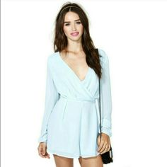 """Nasty Gal """"Up The Street"""" Romper Size S but runs a little large could prob for a M too. Powder blue color. Shown on my friend in the last photo. Long sleeve with plunging v-neck. Super cute, can be dressed up or down. Good condition Nasty Gal Pants Jumpsuits & Rompers"""