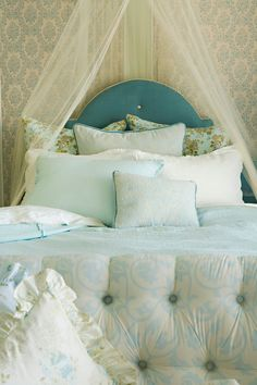 blue, peaceful bed. would make for a nice stay overnight in a fancy place