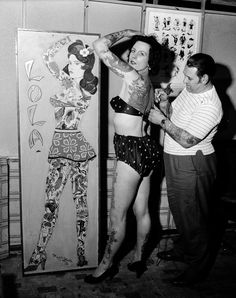 Tattooist Les Skuse at work on champion tattoo lady Pam Nash who has a large Japanese scene across her back April 1960.