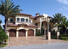 Luxury House Plans front color photo.