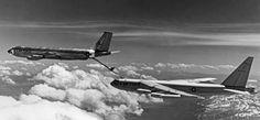 Air Force KC-135 Stratotanker refueling a B-52 bomber.