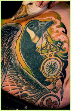 "Canada Goose with golden compass in its beak tattoo | Lars ""Lu's Lips"" Uwe"