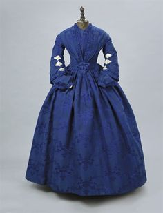 A ROYAL BLUE SILK DAMASK GOWN LATE EARLY once piece, the bodice pointed and with pleated detail to sloping shoulders, the bell sleeves with net insets ands with separate matching undersleeves and associated white gloves worked in blue-purple Victorian Gown, Victorian Costume, Edwardian Dress, Victorian Fashion, Vintage Fashion, Vintage Outfits, Vintage Dresses, 1850s Fashion, Civil War Fashion