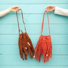 Love the fringe and beaded detailing on this drawstring bucket bag from #TOMS.