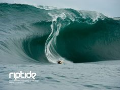 Big wave barrell. Bodyboarding what looks like either Shipsterns Bluff in Tasmania or a huge day at Shark Island, Australia