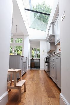 From Design Sponge, beautiful kitchen skylight (sky ceiling? Interior Exterior, Kitchen Interior, New Kitchen, Interior Design, Interior Modern, Kitchen Ideas, Narrow Kitchen, Kitchen Reno, Kitchen Cabinets