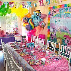 Take a cue from Rainbow Dash and decorate your party room with the colors of the rainbow! My Little Pony birthday banners, scene setters and balloon bouquets = bright idea!