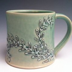 Turquoise Mug made by Jessica Wertz. Slip trailing.  Cup. Handle.