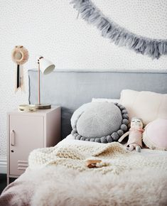 The norsuHOME - Annabel's Bedroom  Photographer: Lisa Cohen Stylist: Beck Simon  Paint: Dulux Mornington Half Wallpaper: These Walls Carpet: Godfrey Hirst   Products:  GlobeWest Vittoria bedhead, Mustard Made Locker, norsu cushions (all available at www.norsu.com.au)