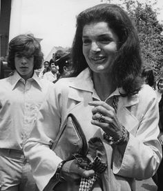 Jackie and John Kennedy Jr.. It looks as if she may be carrying his tie.