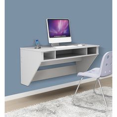 This white floating desk saves precious space in small rooms while creating a modern look for your home. This wall-mounted desk offers a large platform for a computer monitor, books, and a lamp, and the cubby holes let you store needed supplies nearby. Diy Computer Desk, Diy Desk, Computer Science, Computer Station, Floating Wall Desk, Floating Computer Desk, Wall Mounted Desk, White Desks, Hanging Rail