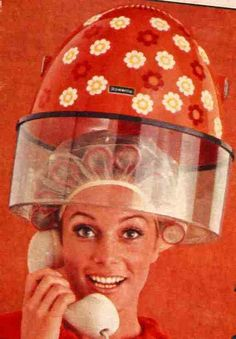 Brush rollers under the dryer by incurlers, via Flickr