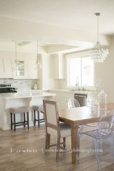 All white classic kitchen and dining inspiration