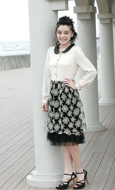 Karen: Vintage midi length dress with button down top and lace embroidered multi layered skirt. Peterpan collar and puff sleeves S-XL.