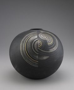 """Samita Masami    """"Remoteness""""  1992.   Porcelain with gold and silver pigments over black glaze"""