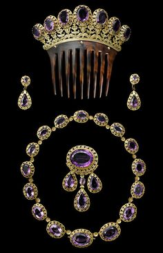 """The Parure collection, made of amethysts and gold, from 1850 by Cartier. The collection is among the many dazzling jewels on display in """"Cartier: Style and History"""" at the Grand Palais in Paris from December 4 through February 16, 2014"""