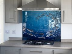 This lovely splashback found a home in Newquay, Cornwall. It depicts a school of mackerel all swimming in unison, all carefully brought to life from hand cut pieces of glass shaped into stylish fish shapes. The main element of fused glass art may be the glass powder which creates the vivid colour of the background, but the fish themselves were actually more traditionally created. Glass Wall Art, Fused Glass Art, Glass Kitchen, Kitchen Art, Cornwall House, Fish Shapes, Custom Glass, Splashback, Panel Art
