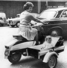 mom and baby girl on motorcycle and side car - vintage - sweet ride