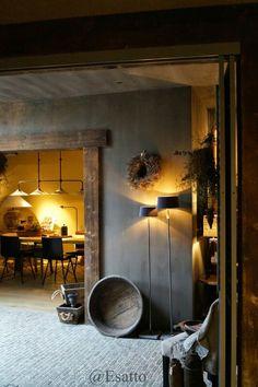 Grey walls. Grey floor. Rustic Wood. Warm atmosphere.
