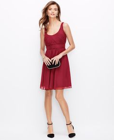 """Exquisitely draped in lightweight silk georgette, this gorgeous dress flaunts an intricately tucked bodice for a couture-worthy finish. Scoop neck. Sleeveless. Tucked bodice. Pleated inset waistband. Scoop back. Hidden back zipper with hook-and-eye closure. Lined. 21 1/2"""" from natural waist. </p> <p> <br /> <br /> <em><span style=""""color: purple;"""">Items in our Weddings """" Events Collection can only be exchanged or returned by mail. <br /></span></em></p>"""