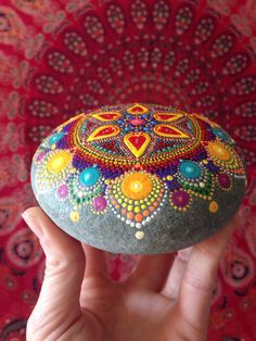 This stone comes from my favorite shoreline, Lawrencetown Beach, Nova Scotia. It has been a work in progress for some time and it is now ready to head out into the world. I have hand-painted this large stone with many dots of acrylic paint. It features a flower design in the center of the stone; moving out from the center, if you look closely you will see that there are hearts between the petals. The artwork has been sprayed with 3+ coatings of protective finish. The stone itself is quite…