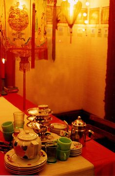 This is JUST what I want my dining room to feel like - chinese restaurant lanterns and flattering lighting...