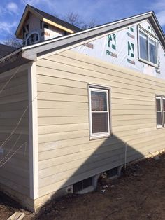 New Hardie board siding going up