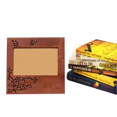 This light maroon coloured #photoframe with wooden engraving depicts a tree with stems and leaves.