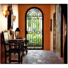 Foyer with black iron gate Spanish style House like this on coffeepot blvd I love!
