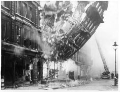 """Bomb damage to 23 Queen Victoria Street during the Blitz. """"The Salvation Army International Headquarters stood on Queen Victoria Street. It was photographed as its facade fell to the ground. Old London, London City, Vintage London, London Wall, Photos Du, Old Photos, Vintage Photos, Le Blitz, Blitz London"""