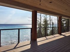Cable Deck Railing with aluminum posts and top rail in Traverse City, MI - Grand Traverse Bay of Lake Michigan