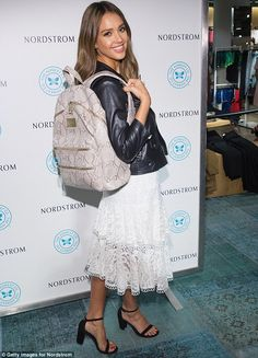 Stunner: The 35-year-old wowed in a white lace dress with a motorcycle jacket at the Thursday event in Seattle, Washington