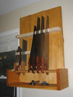 hand saw storage...this guy has an AWESOME shop